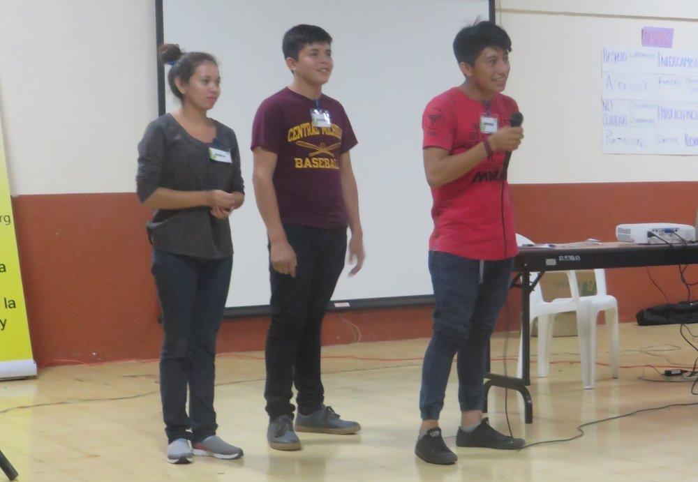 CdA Scholarship students Jessica Idalia, Brayan, and Noel present at the Centro de Intercambio y Solidaridad's annual scholarship student retreat.