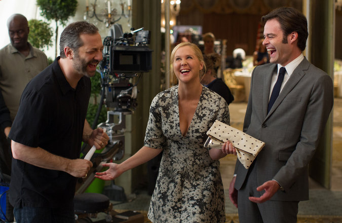 "From left, Judd Apatow, Amy Schumer and Bill Hader on the set of the film ""Trainwreck,"" directed by Judd Apatow. Credit Mary Cybulski/Universal Pictures"