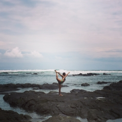 The ultimate in self-care: During a month-long work exchange program at The Yoga Farm Costa Rica, Bonnie settles into Dancers Pose in the tide pools of the Pacific Ocean.