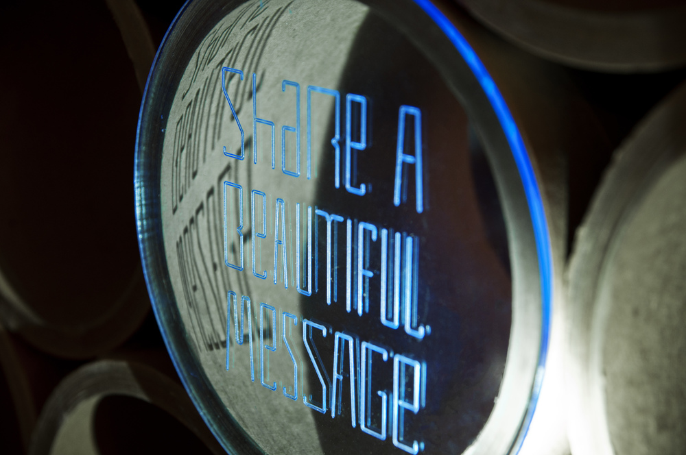 Black lights were used to glow the etched fluorescent plexiglass messages.