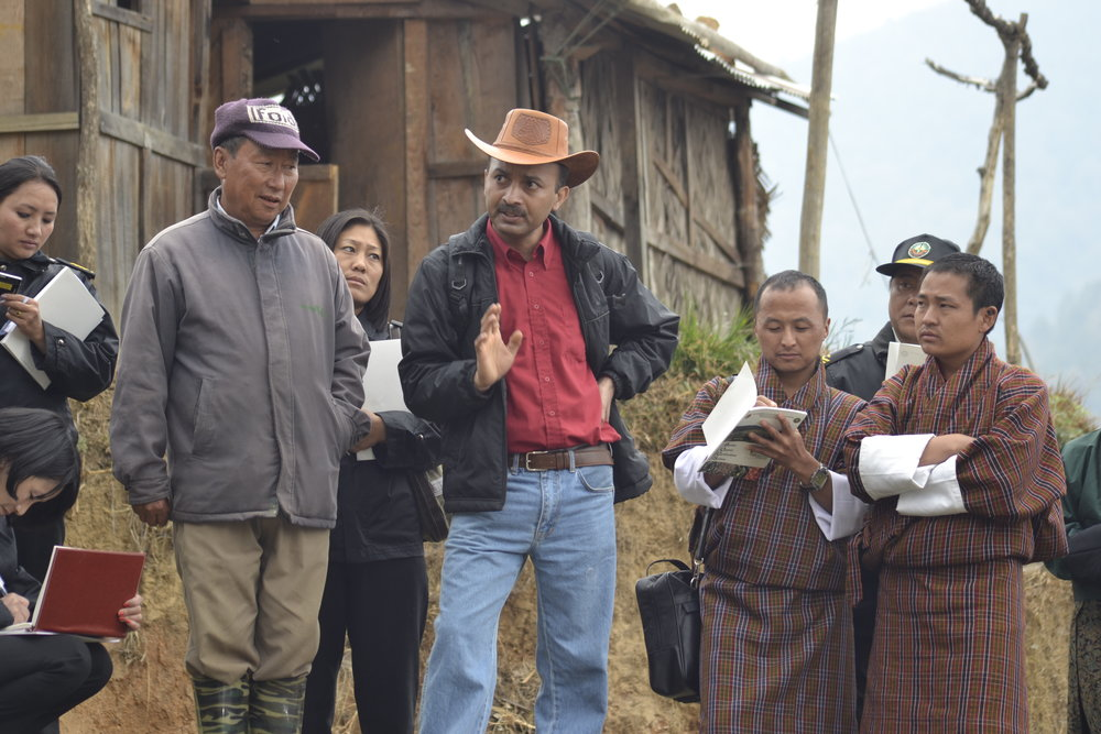 Dr. Thimmaiah (center, in red shirt) worked with officials in Bhutan in their transition to 100 percent organic agriculture.