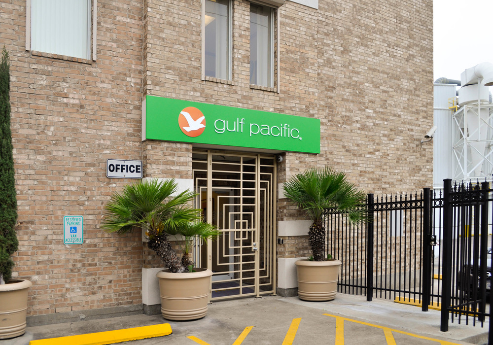 Framed Pan Sign with dimensional letters and logo installed at Gulf Pacific Rice's front entrance.  The sign was designed to provide a clean look without any borders or fasteners showing on the face