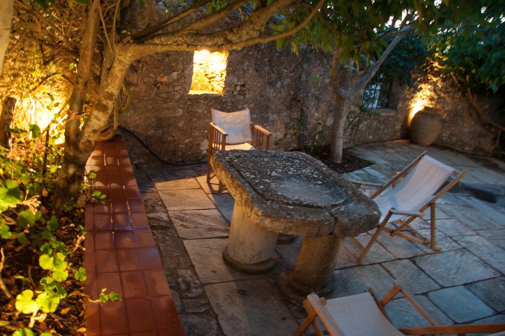 Tholos stone table yard.jpg