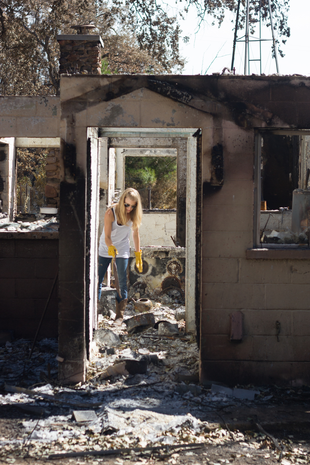 Sifting through rubble at a home destroyed in The Valley Fire