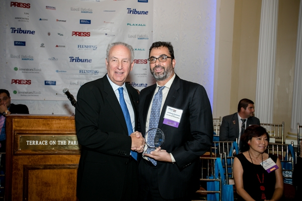 Skyline Risk Management Partner: Anthony Kammas receiving his award from the Queens Tribune 2016 Real Estate Market Place Awards.