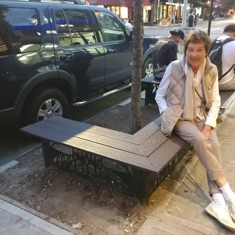 My mom proudly sitting on my bench!