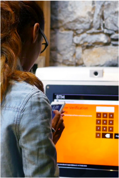 A customer uses a Coin Cloud Bitcoin ATM for the first time