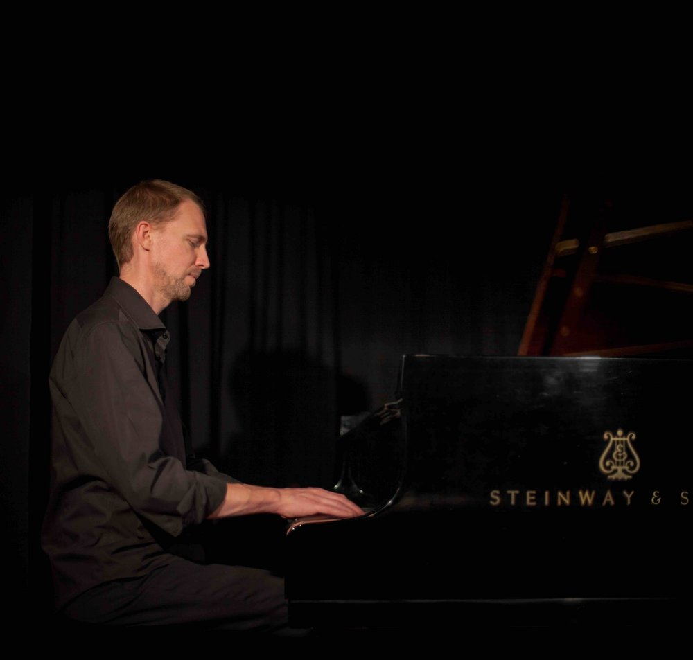 Alexander Technique teacher Jeremy Woolhouse at the piano