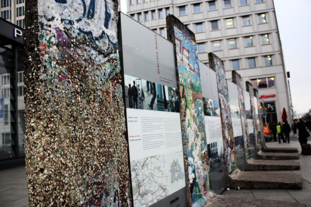 Part of the Wall displayed at Potsdamer Platz. It became common for visitors to place gum on the wall as tribute.