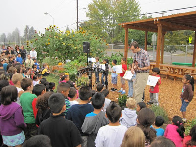 Students helped dedicate the children's garden and Enter to Grow gate with drawings, poems and music.