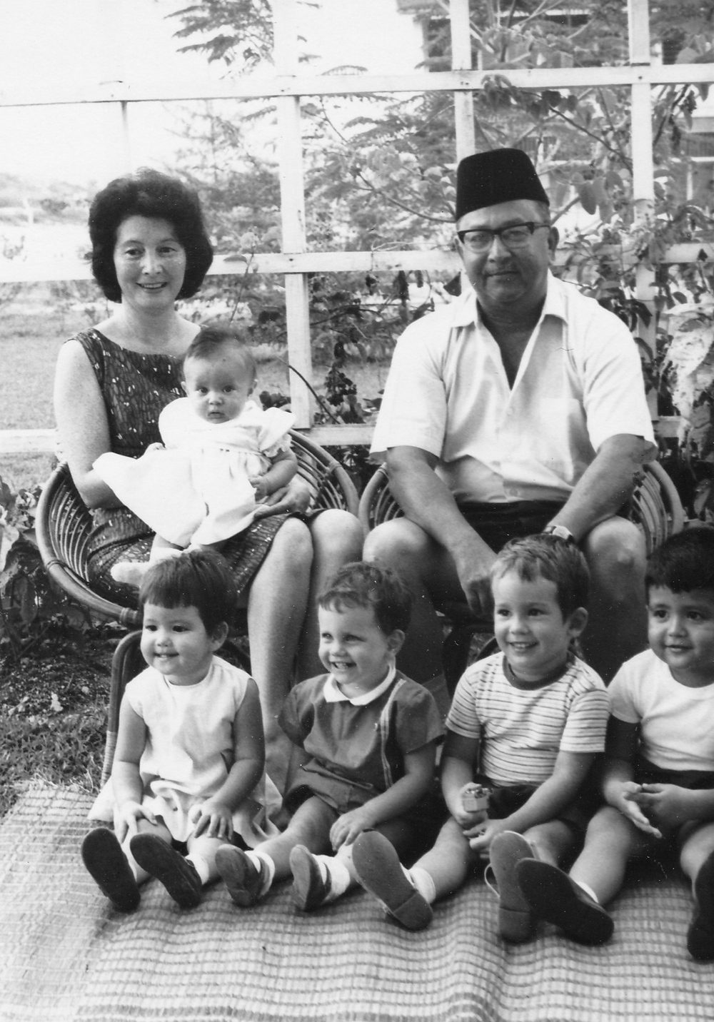 Author as a child in arms with grandparents and cousins circa 1966