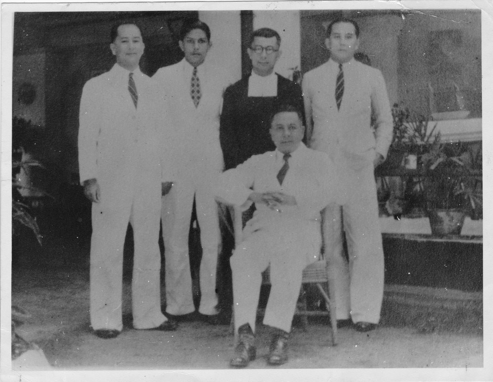 Herman (Snr) seated and sons, Herman, Luke, Brother Justinian, and Pat, circa 1940s in Malaya