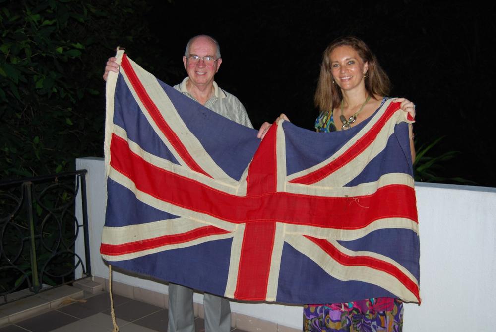 Mickey Alves presenting the original Bahau Union Jack to the author , Singapore, 2010