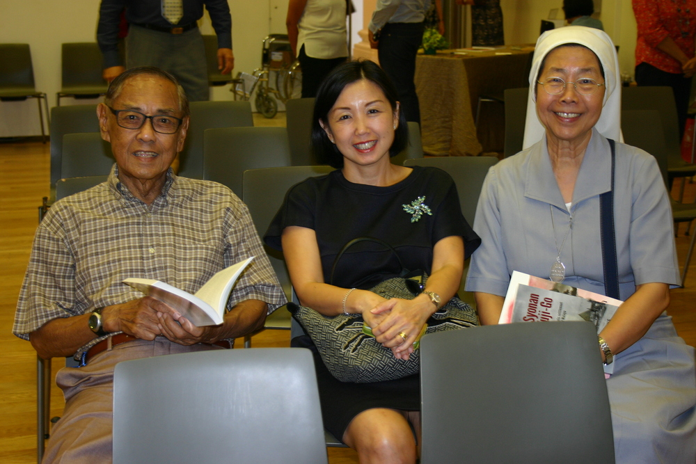 Ex-settler Sam Ong with guests