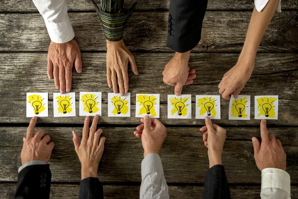 brainstorming-and-teamwork-concept-PR7Z2DL.jpg