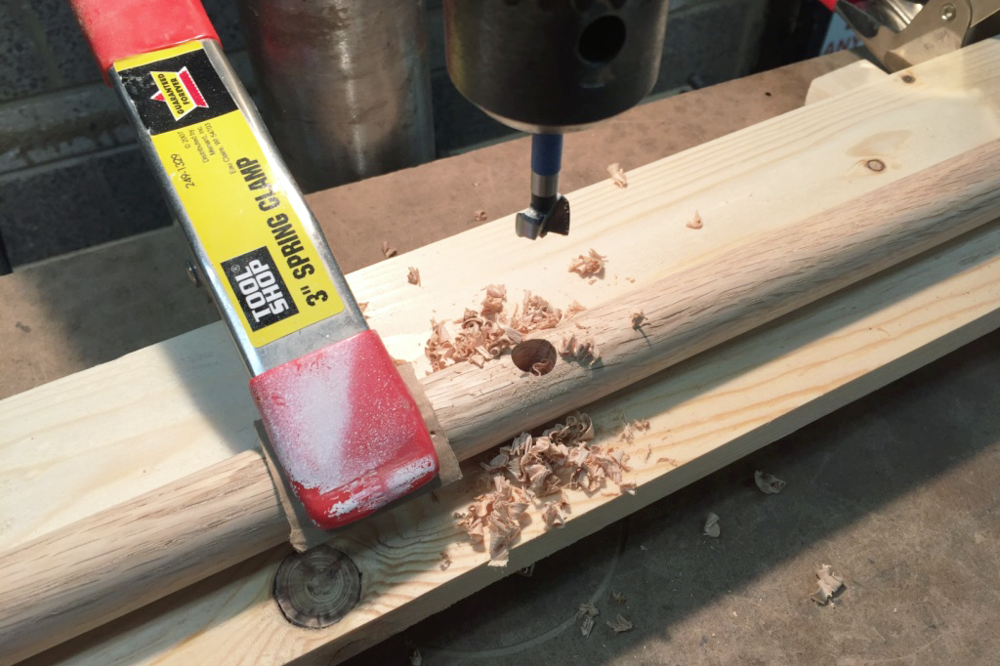 Drilling the holes in the dowels.