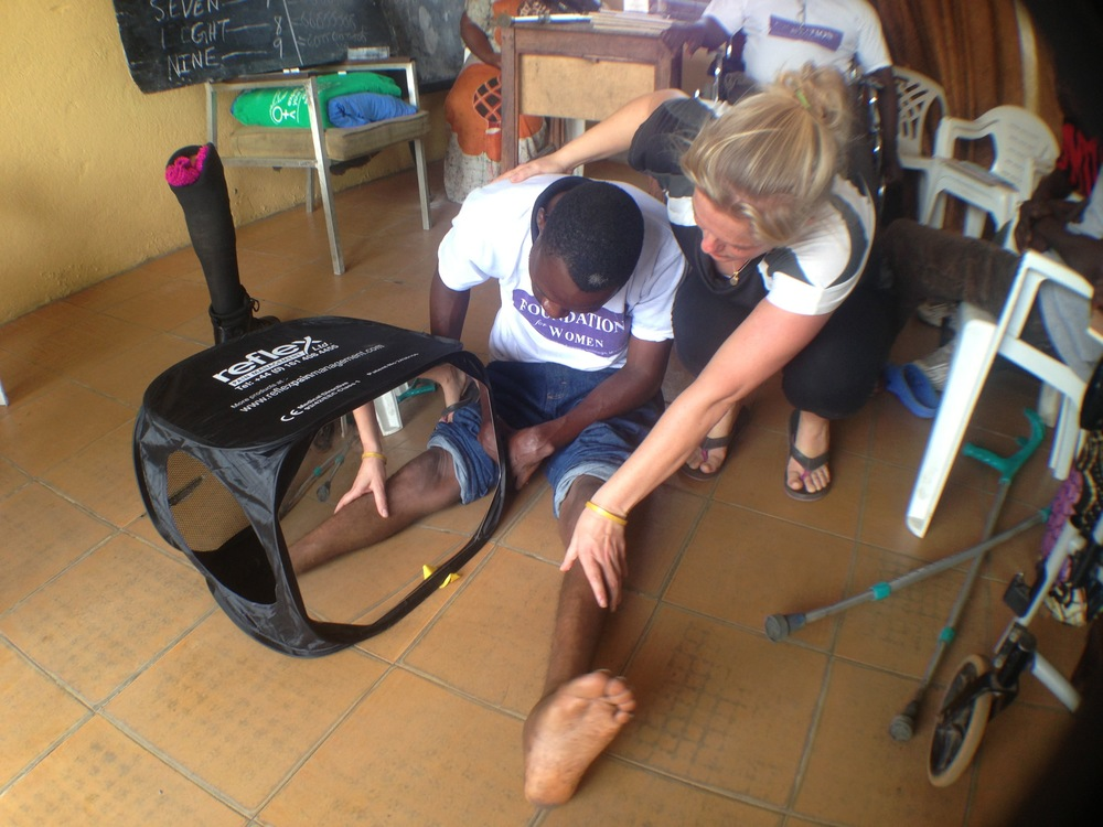 Shannon Lerach using the Mirroring Technique to treat phantom limb pain at the Group of 77 in Liberia.