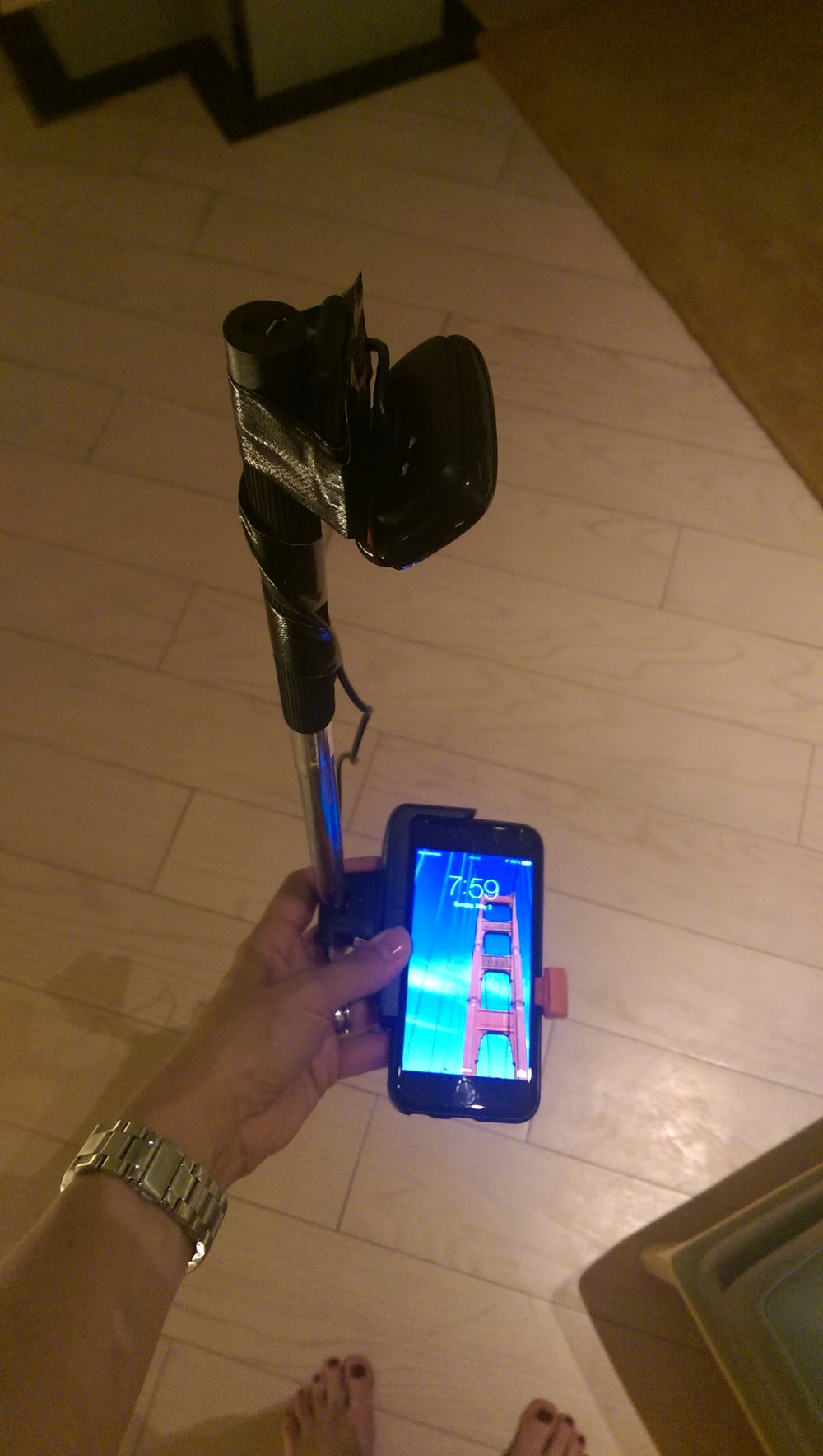 Mobile sled hack - made with a selfie stick, webcam and tape, during a moment of desperation in Indonesia! During usability testing, the participants used their phones in this sled, and observers watched the live stream nearby.