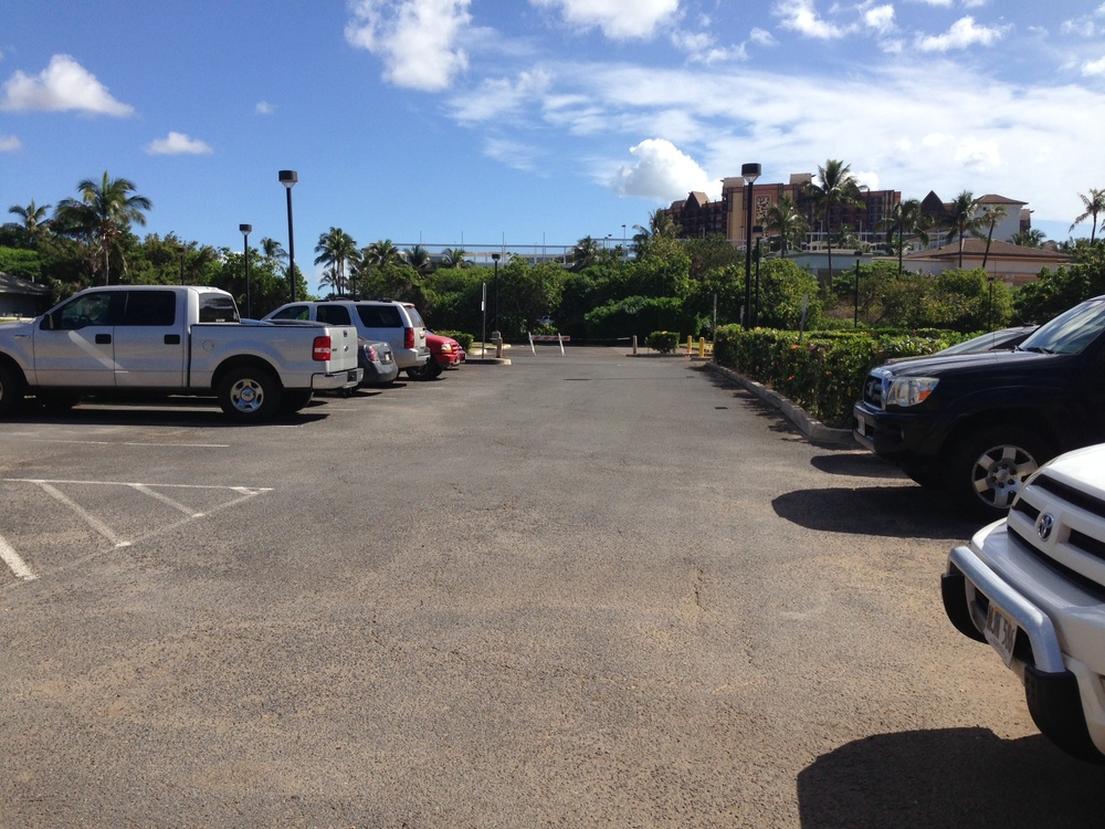 Parking area - about 12 stalls, gets crowded, better to get dropped off if possible.  Take Ko'olina exit, Make a right turn by Lanikuhonua Sign, drive to end where you'll see a parking lot on the right.  Walk down sidewalk to beach path entrance.  Follow path to beach.