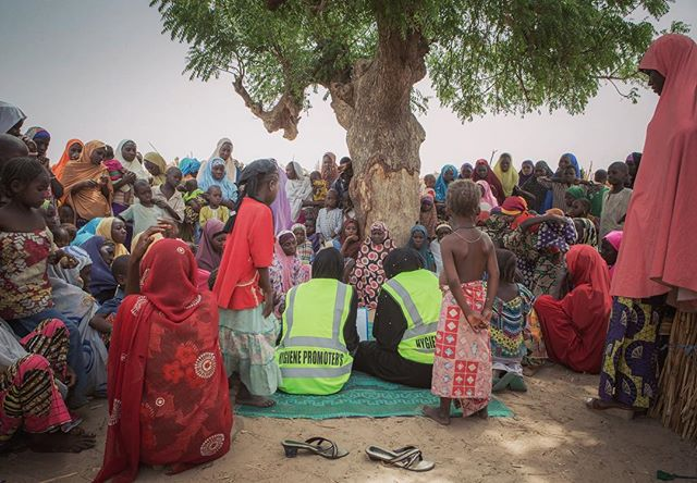 The biggest tree makes for the best conference room. Women and children gathered here everyday I visited Madinatu, a camp for people displaced by Boko Haram in N. Nigeria. Today they're learning how to best avoid disease while living in such tight quarters in the camp. Since @malteserinternational installed a solar powered water pump and trained and employed a team of women as Hygiene Promotors, this camp is a much healthier place, according to the women I spoke with. More than anything, I sensed that the purpose and distraction of the lessons was a respite from the powerlessness of displacement.  April 2018 (c) Emily Kinskey / Malteser International