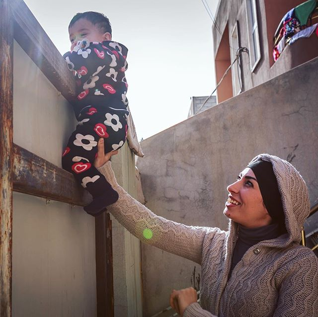 """He loves to look out at the street"" says Imam, of how she pacifies her son Benjamin, who is recently teething and crawling and everywhere.  Sometimes while he naps, Iman tries to write. Before the war, before they left Syria, before she was married and had a son, she wanted to be a poet, to study Arabic literature, for her voice to be heard and acknowledged. ""One day, I hope, if we go back…"" she muses, as if she left that possibility in Syria, with the rest of her life before war.  Sharing stories produced for @womenforwomenuk @womenforwomen about the unique and layered livelihood challenges women face in displacement. January 2018."