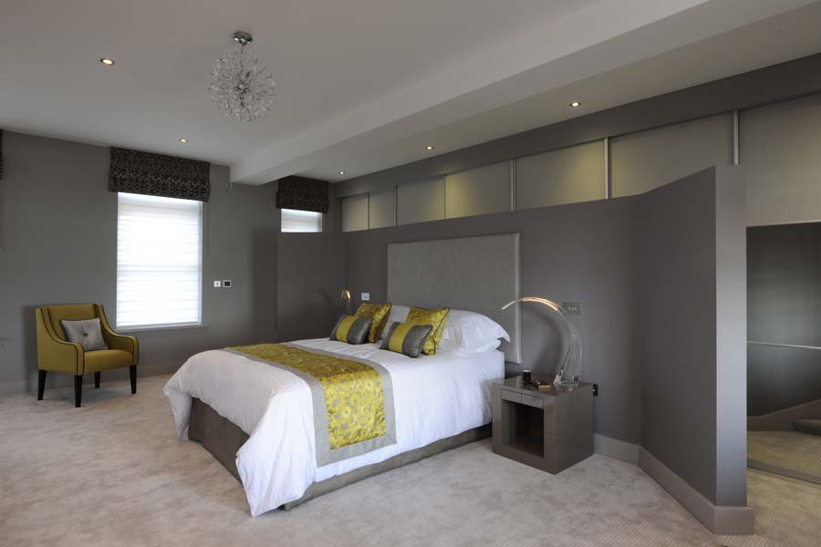 This unit has been individually designed as open plan with a bedroom zone which can be screened off for privacy.