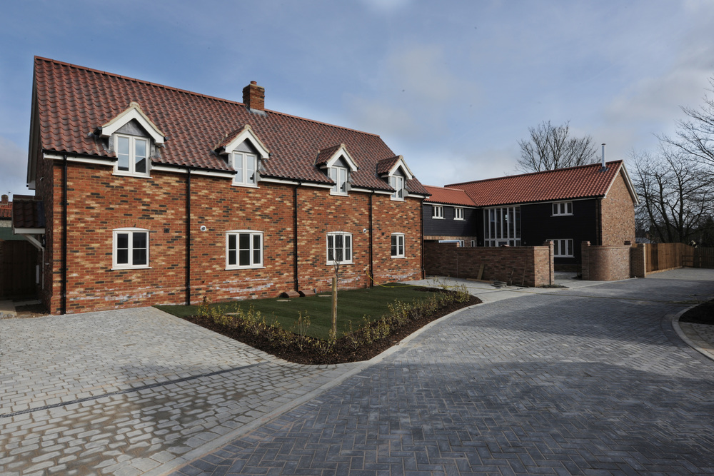 Auction Yard    Development, Haughley    A development of seven detached dwellings. The development was based on the principles of a traditional Suffolk farmstead.
