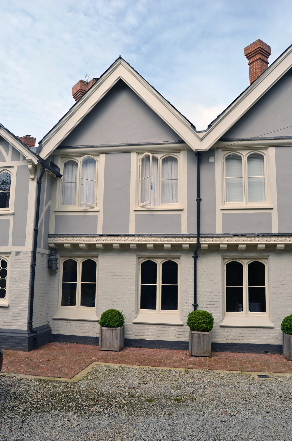 The windows and doors were retained and refurbished in the original style and the property has been painted in more sympathetic colours to provide a soft appearance.