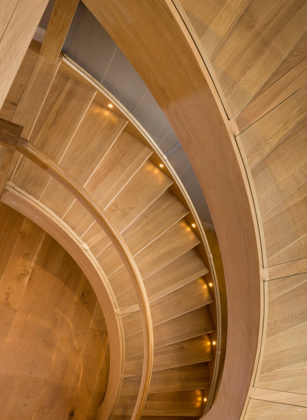 A view down the elegant wooden staircase that sits in proudly in the centre of the home.