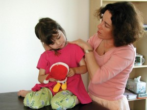 Anat gently uses her hands to spark learning in the brain and body