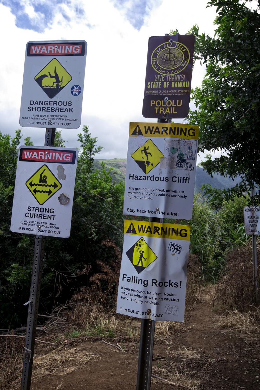 Warning signs at Awini trailhead