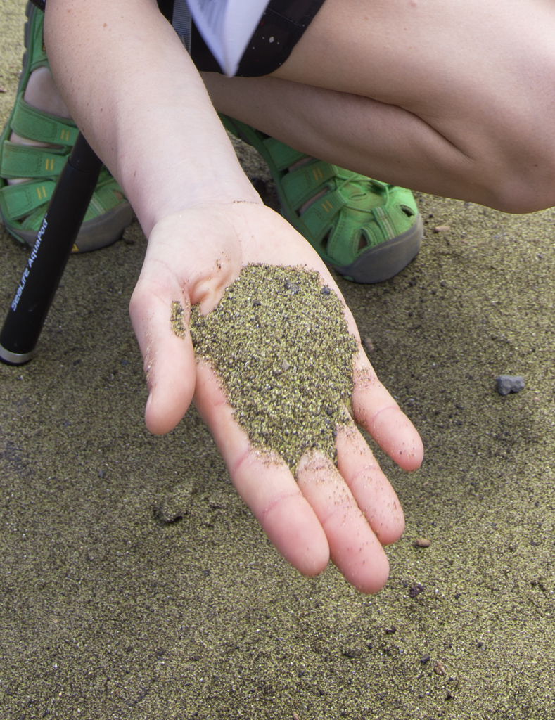 Kamila holding sand that contains olivine