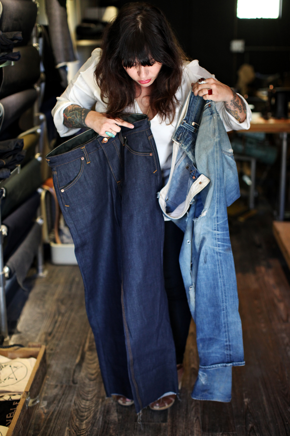 Co-founder Selenia Rios compares new jeans from Traveller Denim Co. (left) to the same jeans that are three years old (right).