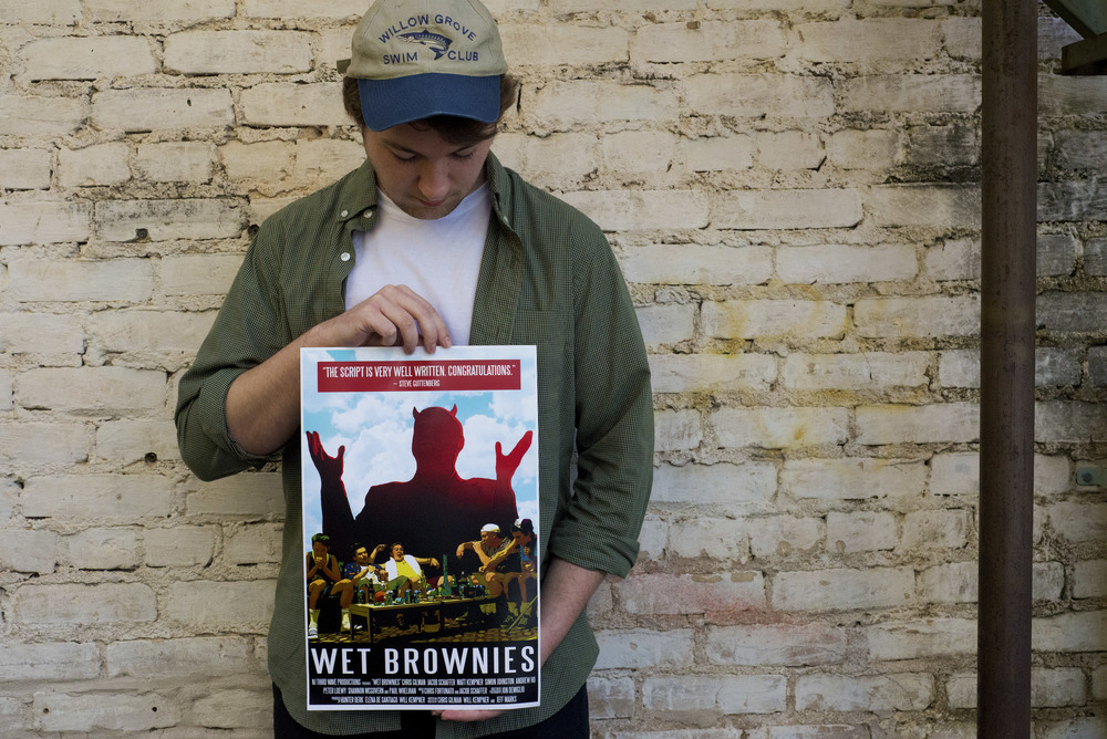"""Debut film directorChris Gilman holds the poster for """"Wet Brownies,"""" releasing Saturday, Feb. 14."""