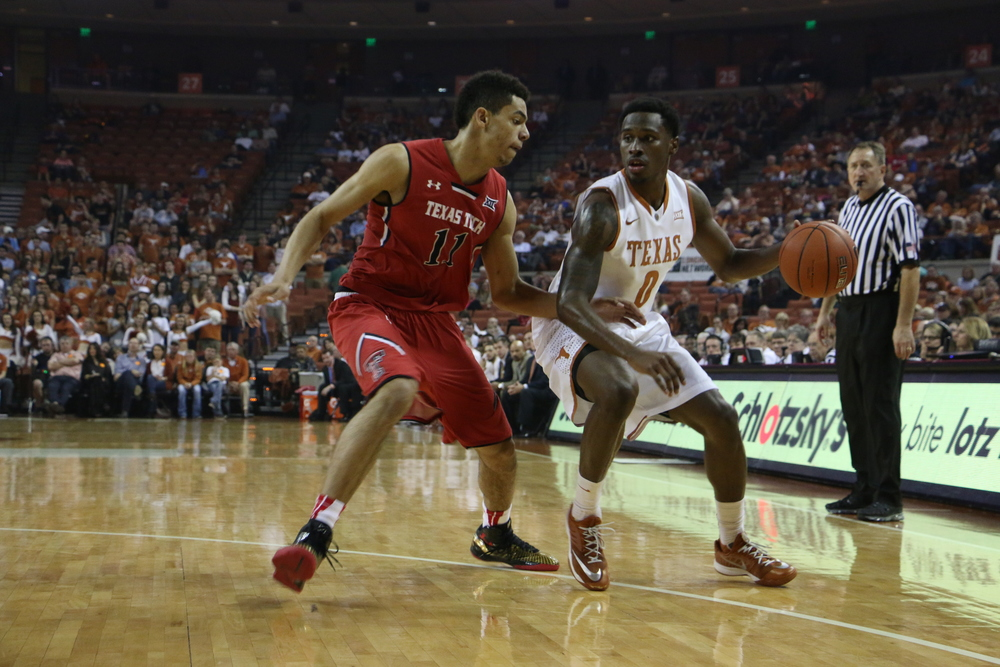 Kendal Yancy guarded by Zach Smith of Texas Tech at a home game on Saturday, Feb. 14.