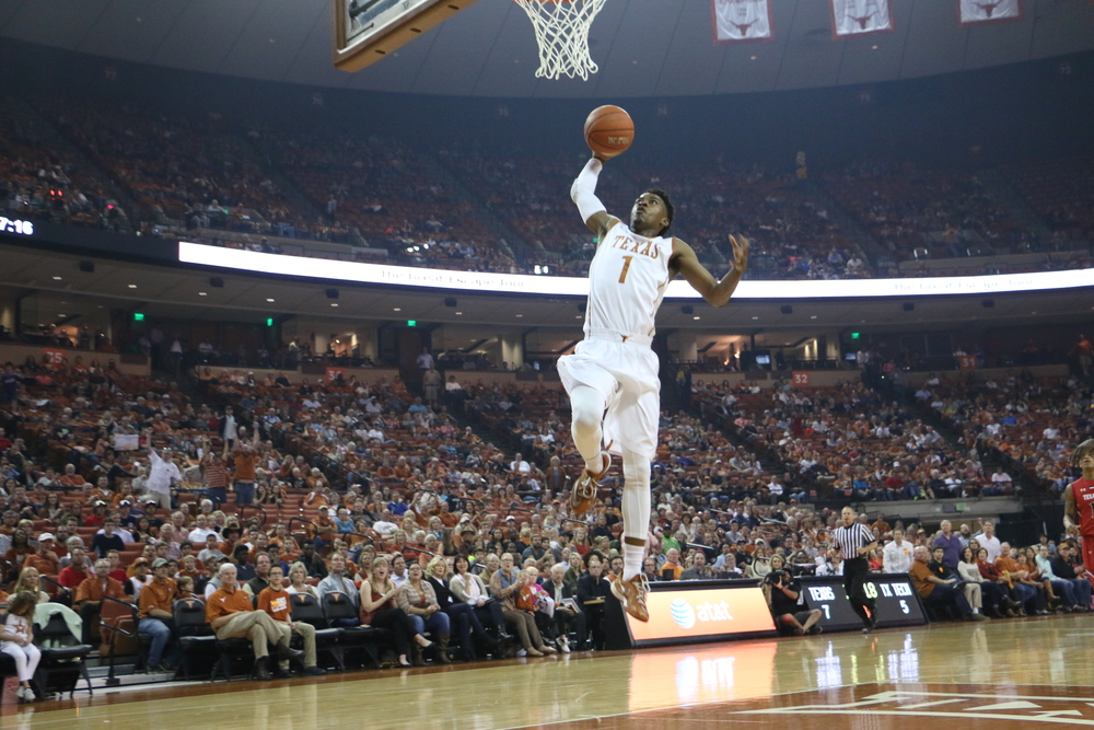 Isaiah Taylor goes up for a slam dunk against Texas Tech on Saturday, Feb. 14.