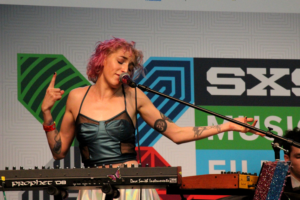 Laura Patino of Austin electronica act Holiday Mountain performs at the Flatstock Stage in the Austin Convention Center. Photo by Tess Cagle.