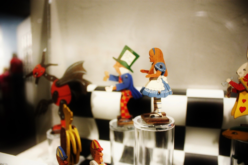 """Alice's Adventures in Wonderland"" and ""Through the Looking Glass"" wooden figurines."
