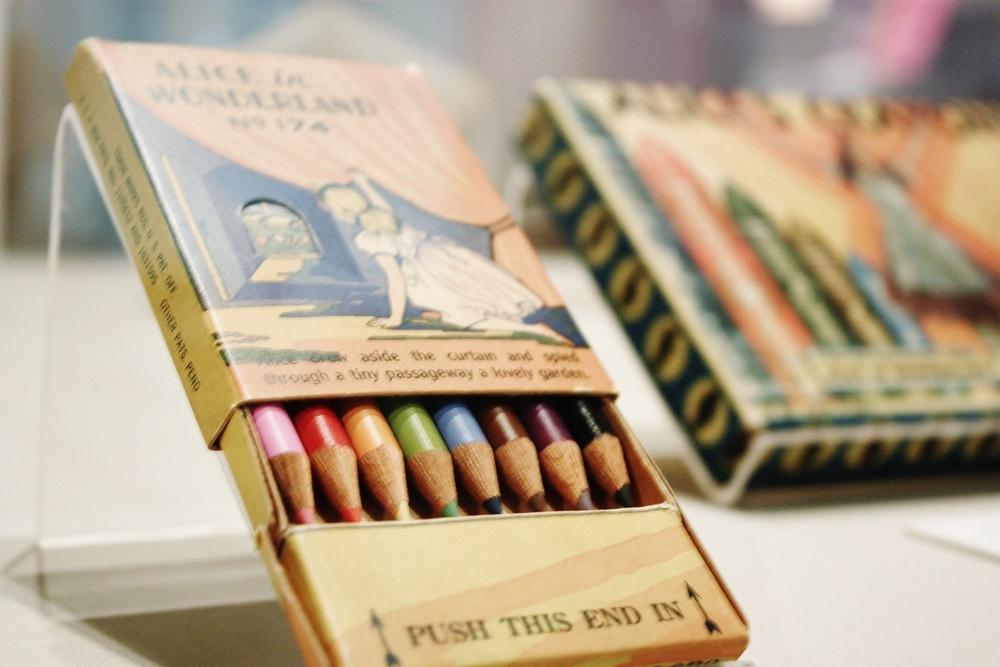 """Antique """"Alice in Wonderland"""" colored pencils."""