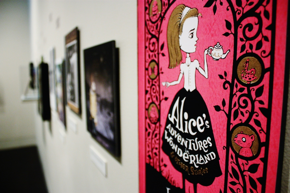 "A recent book cover of the story ""Alice in Wonderland."""