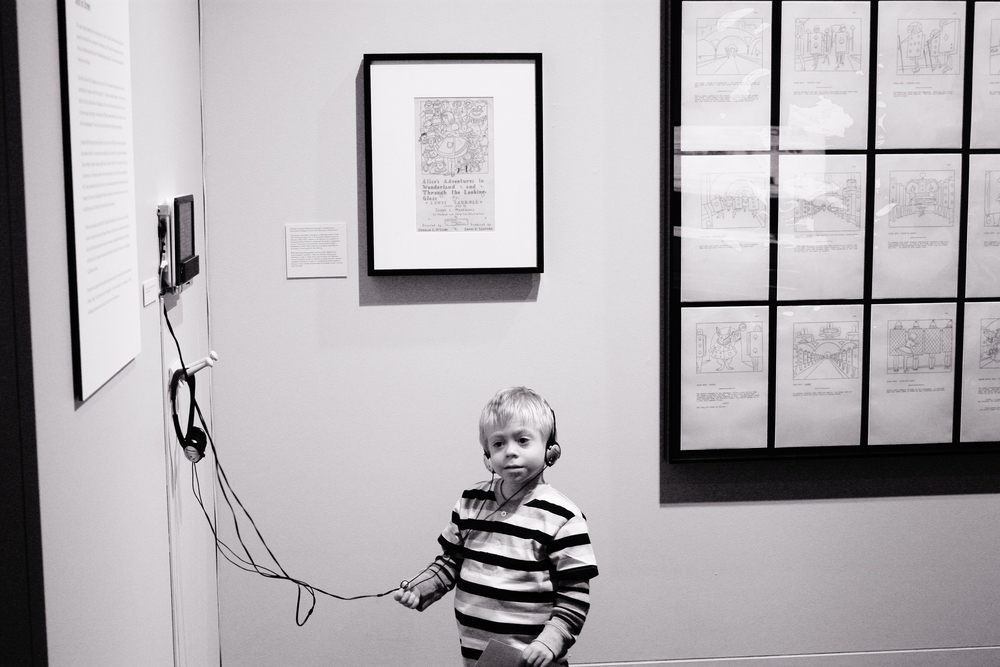"A young boy listens to an audio tape of the book ""Alice's Adventures in Wonderland."""