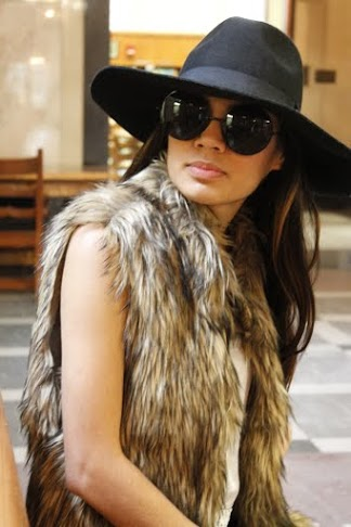 Throw shade and channel your inner 70s rock goddess in oversized faux fur vests and sunglasses. Fur vest and hat courtesy of Jenna Bell.