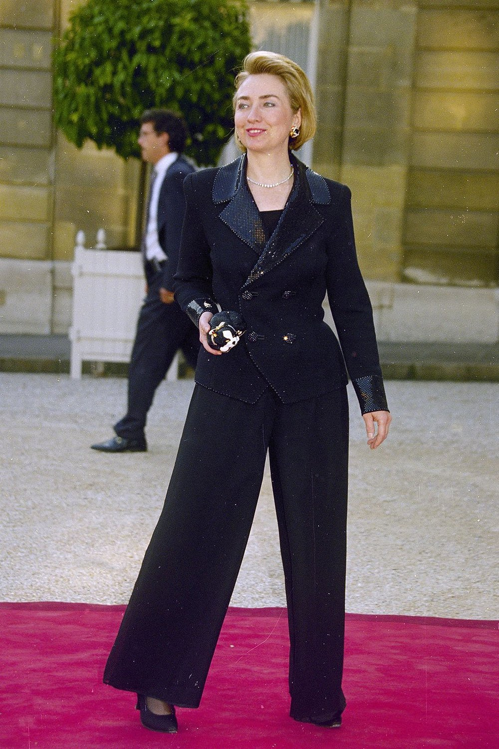 2. 1994- Slaying in Sequins       Clinton rocks the red carpet in Paris. Note the cat clutch and flared pant legs.
