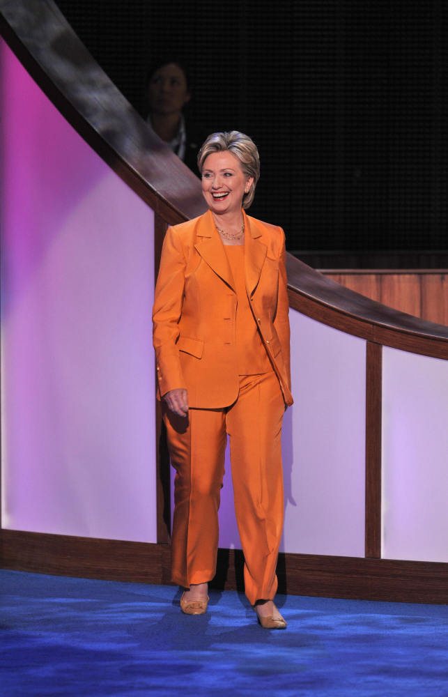 3. 2008- Owning the Orange       Strolling into the Democratic National Convention in Denver, Clinton reps some electric orange.
