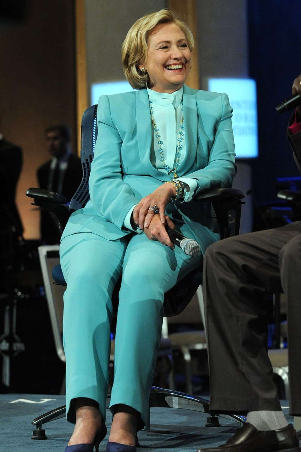 5. 2013- Tasteful in Teal       With a conservative neckline and dazzling accessories, Hillary takes on an interview.