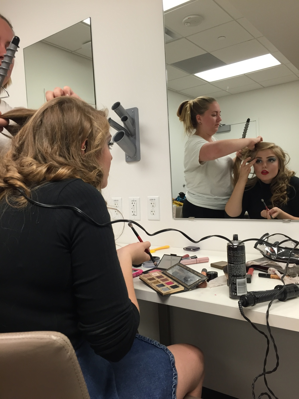 Journalism freshman Julienne Bajusz getting ready to perform in the Rocky Horror Picture Show Quote-Along on Oct. 28. Bajusz played the role of Dr. Frank-N-Furter.