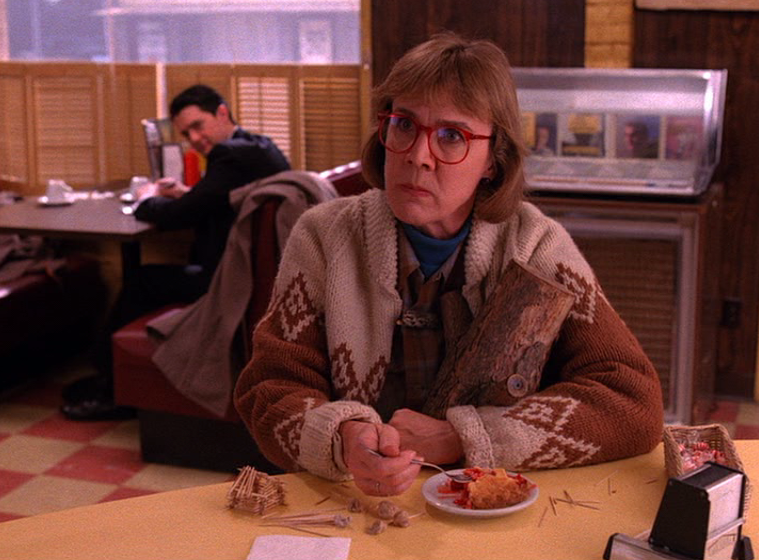 THE LOG LADY    What horrors has the Log Lady seen? Whatever secret she's hiding, it's obvious that it could put someone important behind bars. The Log Lady often wears cardigans and sweaters with intricate patterns, perhaps reflecting her hidden, detailed knowledge of Laura Palmer's murder. Unleash your inner supernatural, log-bearing medium with a cozy sweater cardigan from    Pendleton   .