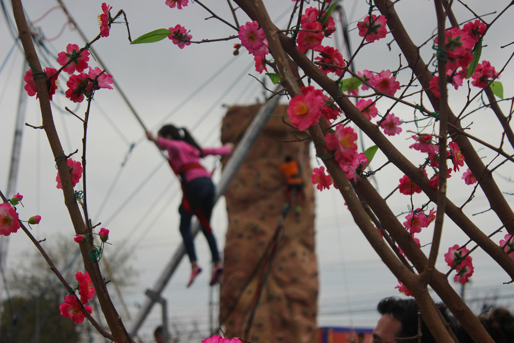 There are a multitude of attractions at the festival, including rock climbing and trampoline jumping with bungee cords.