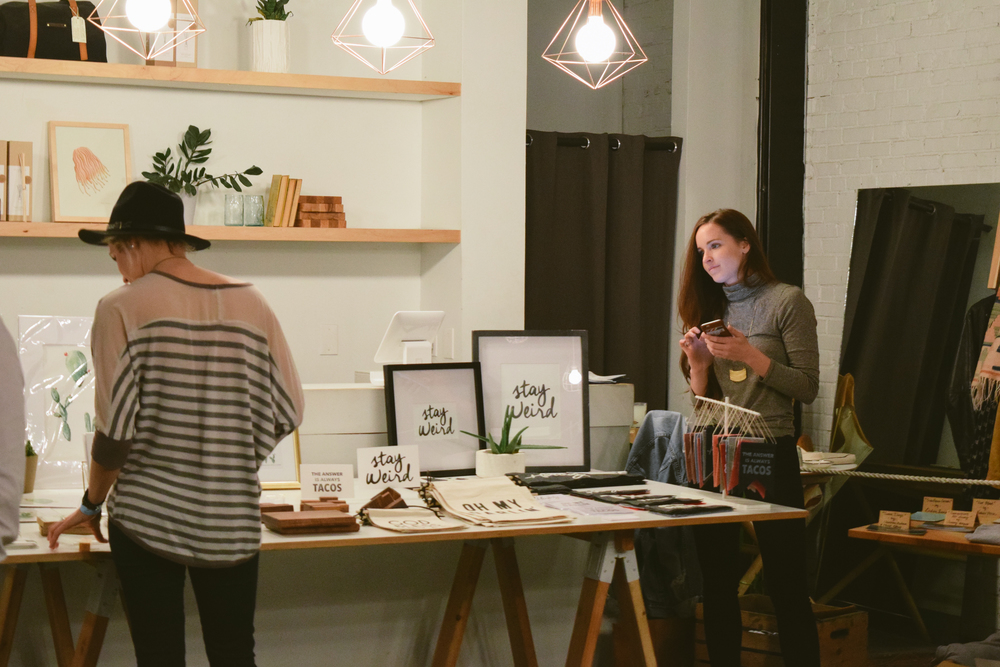 Frankie Jean, a local design and creative collective, selling merchandise at the show.