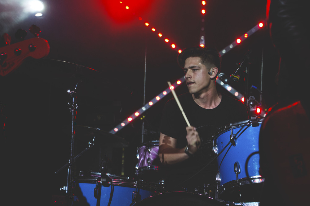Jacob Wick plays the drums